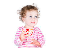 Lttle girl with a heart shaped candy Royalty Free Stock Photography
