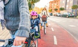 Lttle girl with helmet on head sitting in bike Stock Images