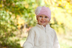 Lttle girl in a knitted cap Stock Images