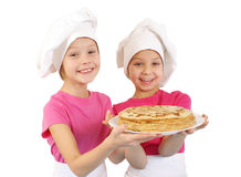Lttle girls with pancakes Royalty Free Stock Photos