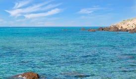 Lu Bagnu sea. Turquoise sea and rocks in Lu Bagnu Stock Image