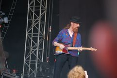 Trencin, Slovakia - July 9, 2011: Lu Edmonds playing guitar live with Public Image limited PIL, ex Sex Pistols at Pohoda Festi stock photography