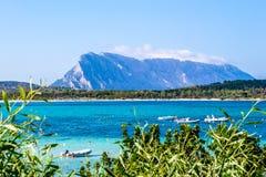 Lu impustu beach in Sardinia, with Tavolara island in the backgr stock photography