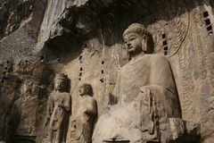 Lu She Na Buddha at Longmen Grottoes. Longmen Grottoes and the Lu She Na Buddha carving royalty free stock image