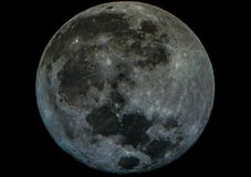 A Lua cheia olha como uma pedra imagens de stock