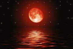 Lua e estrelas vermelhas ensanguentados grandes Fotos de Stock Royalty Free