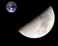 Lua e terra Imagens de Stock