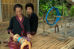 Lua Hill Tribe minority is spinning reels is made of bamboo in T Stock Image