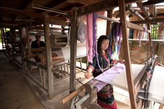 Lua Hill Tribe minority is weaving with loom in Thailand. Royalty Free Stock Photography