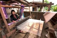 Lua Hill Tribe minority is weaving with loom in Thailand. Stock Photography
