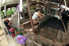 Lua Hill Tribe minority is weaving with loom in Thailand. Royalty Free Stock Images