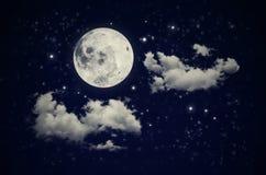 Lua, nuvens e estrelas Fotos de Stock