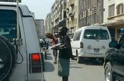Luanda, Angola. Street vendor selling to passing traffic on a street in Luanda, Angola Stock Photos