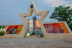 LUANDA, ANGOLA - APRIL 28 2014: Civil war memorial depicting Angolan flag and soldiers at Fortaleza de Sao Miguel Royalty Free Stock Photos