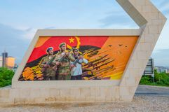 LUANDA, ANGOLA - APRIL 28 2014: Civil war memorial depicting Angolan flag and soldiers at Fortaleza de Sao Miguel Royalty Free Stock Photography