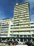 Downtown Luanda high rise building. LUANDA, ANGOLA - MARCH 29 2018: Typical commercial building in downtown Luanda Angola with multiple aircon units on exterior royalty free stock photography