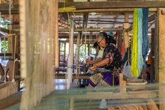 Unidentified woman weaving silk in Luang Prabang, Laos. royalty free stock images
