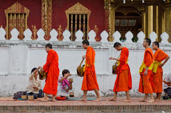LUANG PRABANG, LAO - MAY 12: Every day very early in the morning Royalty Free Stock Photos