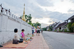 LUANG PRABANG, LAO - MAY 12:Tourist waiting for the monks. Every Royalty Free Stock Photography