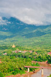 Luang Prabang, Laos. Aerial view of Luang Prabang and the Nam Khan River, with mountains in the background as shot from Mount Phousy Stock Photo