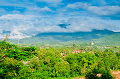 Luang Prabang, Laos. Aerial view of Luang Prabang and the Nam Khan River, with mountains in the background as shot from Mount Phousy Royalty Free Stock Image