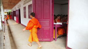 LUANG PRABANG, LAOS - APRIL 2014: buddhist monk school stock footage