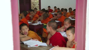 LUANG PRABANG, LAOS - APRIL 2014: buddhist monk school stock video footage