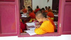 LUANG PRABANG, LAOS - APRIL 2014: buddhist monk school. LUANG PRABANG, LAOS - APRIL 2014: Buddhist school education, monk learning their teaching, Laos stock footage
