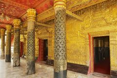 Elaborate golden facade decoration of the Wat Xieng Thong Buddhist temple in Luang Prabang, Laos. LUANG PRABANG, LAOS - APRIL 16, 2012: Elaborate golden facade royalty free stock image