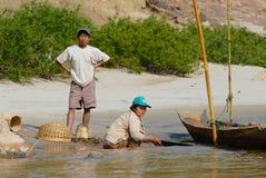People do gold plating at the sandy bank of the Mekong river in Luang Prabang, Laos. stock image