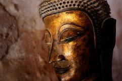 gold plated buddha statues in a cave around the town royalty free stock image
