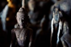 Small buddhist statues in a cave around the town stock photography