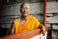 smoking head buddhist monk resting at his monastery during the afternoon heat with glasses stock photos