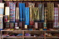 LUANG PRABANG, LAOS - 30 June 2018 - Hand woven fabrics are in d royalty free stock images