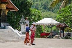 LUANG PRABANG, LAOS - MAY 12 :  Female visitors must dress modes Stock Image