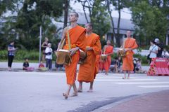 Luang Prabang, Laos, monks and people in the alms giving ceremony, 16-july-2017 royalty free stock photos