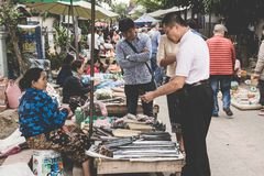 A local Laotian Hill tribe woman sells commodity at the daily morning market in Luang Prabang, Laos on the 13th NOVEMBER, 2017. LUANG PRABANG, LAOS - NOVEMBER royalty free stock photography