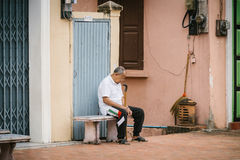 LUANG PRABANG, LAOS - OCTOBER 26; Unidentified man sleeping on the street on October 26, 2014. Royalty Free Stock Photography