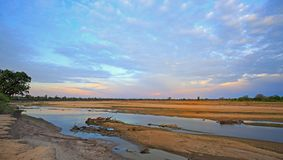 The Luangwa River at sunset in Zambia. Scenic view of the Luangwa River at sunset, with a nice cloudscape in South Luangwa National Park, Zambia, Southern Africa Stock Photos