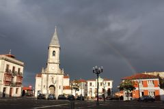 Luarca church with rainbow Royalty Free Stock Image