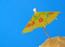 Luau party cupcake with umbrella Royalty Free Stock Photography