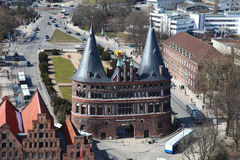Lubeck. Aerial view on the Holsten Gate (Holstein Tor, later Holstentor), a city gate marking off the western boundary of the old center of the Hanseatic city of Royalty Free Stock Photos