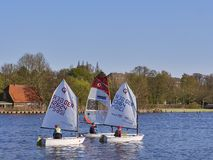 LUBECK, GERMANY - APRIL 21, 2018: Children on sailing boats. On the river Stock Photography
