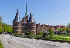 Lubeck, Germany - May 7, 2017: Summer view of The Holsten Gate or Holstentor in Lubeck old town - Germany, Schleswig-Holstein Royalty Free Stock Image