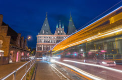 Lubeck, Germany. Medieval Holstentor gate at night with car and Royalty Free Stock Image