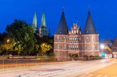 Lubeck, Germany. Medieval Holstentor gate at night with car ligh Stock Photography
