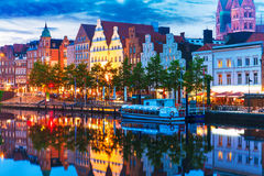 Lubeck, Germany. Scenic summer evening view of the Old Town pier architecture in Lubeck, Germany Stock Images