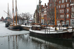 Lubeck harbour in winter. Lubeck harbour in Germany with the river partly frozen Stock Images