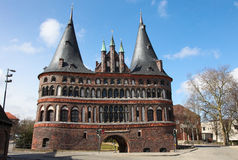 Lubeck. The Holsten Gate (Holstein Tor, later Holstentor) is a city gate marking off the western boundary of the old center of the Hanseatic city of Lubeck Royalty Free Stock Photography