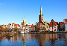 Lubeck old town, Germany. Lubeck old town with Marienkirche (St. Mary's Church) and Petrikirche (St. Peter's Church) reflected in Trave river, Germany Royalty Free Stock Photos